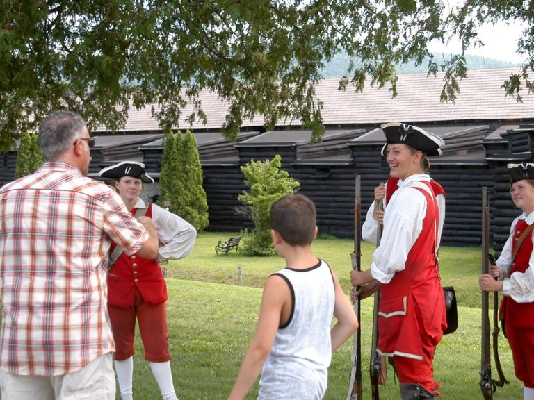 War reenactors talking with guests at Fort William Henry Museum in Lake George NY