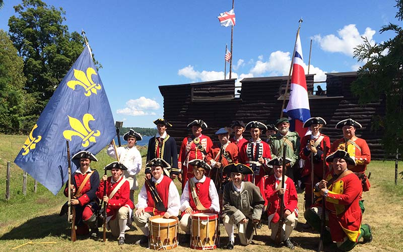 Reenactors gathered for a group photo with french flags